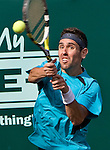 Wayne Odesnik of the United States hits a backhand in his quarterfinal tennis match against Xavier Malisse of Belgium at the U.S. Men's Clay Court Championships at River Oaks Country Club in Houston, Friday, April 9, 2010. Odesnik won the match 6-4, 6-1.  (AP Photo/Steve Campbell)