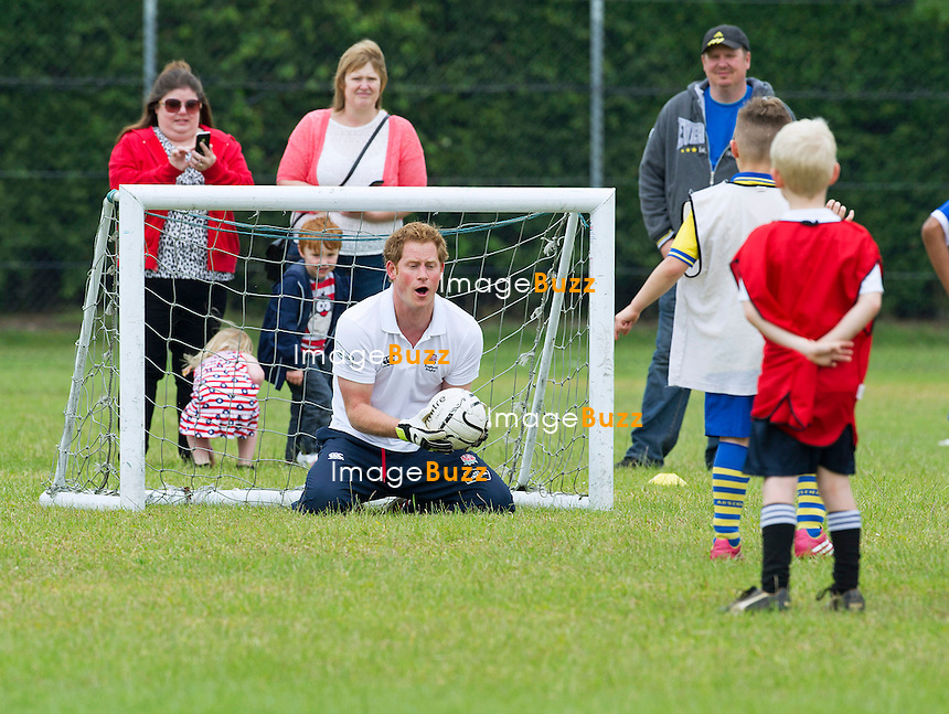 PRINCE HARRY <br /> plays football with young children at Inspire Suffolk, Ipswich.<br /> 29 May, 2014.
