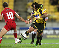 Ma'a Nonu grubbers past Quade Cooper during the Super 14 rugby match between Hurricanes and Reds at Westpac Stadium, Wellington, New Zealand on Friday, 7 May 2010. Photo: Dave Lintott / lintottphoto.co.nz