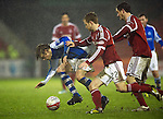 Aberdeen v St Johnstone..22.12.12      SPL.Murray Davidson is fouled by Mark Reynolds and Scott Vernon.Picture by Graeme Hart..Copyright Perthshire Picture Agency.Tel: 01738 623350  Mobile: 07990 594431