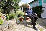Jim in the garden of his prefab at the Excalibur estate in Catford, South London. He has been living in his prefab for 20 years and is fighting to save it as the Lewisham Council want to pull the prefabs down. Thousands of post-war prefabs are still being lived in and cherished by their tenants or owners all over the UK.