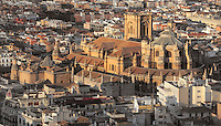 Granada Cathedral, or the Cathedral of the Incarnation, built 16th and 17th centuries in Renaissance style with Baroque elements, viewed from the Alhambra Palace, Granada, Andalusia, Southern Spain. Several architects worked on the cathedral, which, unusually, has 5 naves and a circular capilla mayor instead of an apse. Granada was listed as a UNESCO World Heritage Site in 1984. Picture by Manuel Cohen