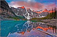 In this Rocky Mountain Image, I visited this location in Banff National Park 5 days in a row. Each day I was greeted by clouds and rain. Then on the last day, the sun finall broke through. I stood on the shore and captured this image of Moraine Lake as sun nipped across the peaks of the Canadian Rockies.<br /> <br /> I think I was the only person awake that morning. Those other folks sure missed a beautiful sunrise over Moraine Lake