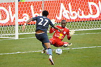 New York Red Bulls goalkeeper Bouna Coundoul (18) comes off his line to deny Jo Silva (27) of Manchester City F. C.  during a Barclays New York Challenge match at Red Bull Arena in Harrison, NJ, on July 25, 2010.