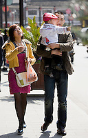 Couple with their son in the Yu Garden Bazaar. China has a one child family planning policy to reduce population