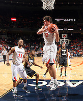 CHARLOTTESVILLE, VA- DECEMBER 6: Joe Harris #12 of the Virginia Cavaliers grabs a rebound in front opf George Mason Patriot defenders during the game on December 6, 2011 at the John Paul Jones Arena in Charlottesville, Virginia. Virginia defeated George Mason 68-48. (Photo by Andrew Shurtleff/Getty Images) *** Local Caption *** Joe Harris