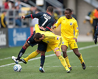Mar 26, 2011; Columbus, OH, USA; Columbus Crew midfielder Dejan Rusmir (22) knocks the ball away from New York Red Bulls defender Roy Miller (7) during their match at Columbus Crew Stadium. The game finished in a 0-0 tie.