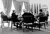 Extra chairs were pulled into the Oval Office in the White House in Washington, D.C. on October 9, 1974 when United States President Gerald R. Ford's senior advisors gathered around his desk for one of their frequent meetings.  Counter-clockwise from President Ford, these advisors are as follows: Ronald H. Nessen, Press Secretary; John O. Marsh, Jr., Counsellor; Philip W. Buchen, Counsel; Donald Rumsfeld, Assistant; Paul Miltich, Assistant Press Secretary; Brent Scowcroft, Deputy Assistant for National Security Affairs; and Robert Hartmann, Counsellor.<br /> Mandatory Credit: David Hume Kennerly / White House via CNP