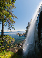 Side view of unnamed waterfall along Chatham Strait on east side of Baranof Island in the Inside Passage of Southeast Alaska. Summer. Afternoon.