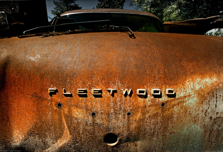 There is quite a bit of rusty patina on this abandoned Fleetwood cruiser in USA.