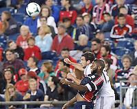 New England Revolution defender Andrew Farrell (2) and D.C. United midfielder Chris Pontius (13) battle for head ball.  In a Major League Soccer (MLS) match, the New England Revolution (blue) defeated D.C. United (white), 2-1, at Gillette Stadium on September 21, 2013.