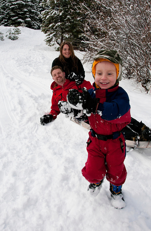 California, Lake Tahoe: Young family with child  enjoy snow play with sled at North Lake Tahoe Regional Park.  Photo copyright Lee Foster.  Photo # cataho107652