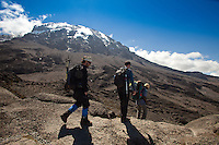 Climbing Kilimanjaro - Just after scalling the Baranco wall the scene opens up to vast views of the peak as our team moves forward across the plateau.