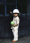 Small child poses with a ball in Hanoi, North Vietnam.  (Jim Bryant Photo)......