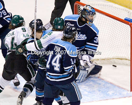 Ben Bishop (University of Maine - Des Peres, MO) looks behind him as Mike Ratchuk (Michigan State - Buffalo, NY) and Chris Mueller (Michigan State - West Seneca, NY) begin to celebrate Mueller's goal which put Michigan State on the board - Keenan Hopson (University of Maine - Prince George, BC), Billy Ryan (University of Maine - Milton, MA). The Michigan State Spartans defeated the University of Maine Black Bears 4-2 in their 2007 Frozen Four semi-final on Thursday, April 5, 2007, at the Scottrade Center in St. Louis, Missouri.