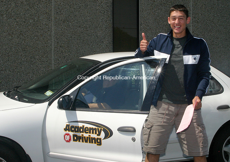 WATERTOWN, CT -22 AUGUST 2008 082208DA04.jpg- Academy of Driving student, Dan Silverio,16, of Bristol is all smiles after passing the road evaluation test from the inspector of Department of Motor Vehicle in Watertown Friday.<br /> Darlene Douty/Republican-American