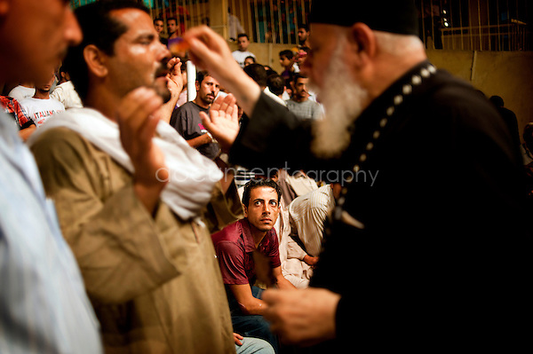 Father Samaan at the end of an exorcism session with a Muslim.<br /> <br /> copyright : Magali Corouge / Documentography