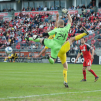 23 April 2011: Toronto FC goalkeeper Stefan Frei #24 and Columbus Crew forward Tom Heinemann #32 in action during a game between the Columbus Crew and the Toronto FC at BMO Field in Toronto, Ontario Canada..The game ended in a 1-1 draw.