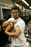 PHOENIX, AZ - MARCH 6:  Eric Chavez of the Oakland Athletics in the clubhouse before the game against the Chicago Cubs at Phoenix Municipal Stadium on March 6, 2006 in Phoenix, AZ. (Photo by Michael Zagaris /MLB Photos via Getty Images) *** Local Caption *** Eric Chavez
