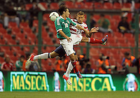 MEXICO CITY, MEXICO - AUGUST 15, 2012:  Fabian Johnson (23) of the USA MNT heads the ball against Andres Guardado (8) of  Mexico during an international friendly match at Azteca Stadium, in Mexico City, Mexico on August 15. USA won 1-0.