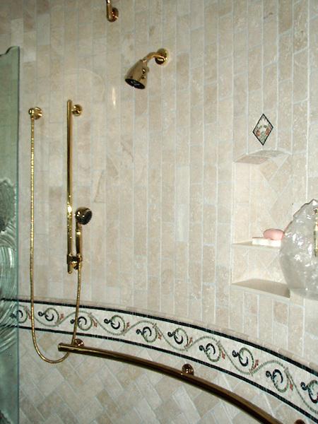 "Custom stone mosaic bath shown designed with a 5 3/4"" Gadfly border, a 5 3/8"" Cape Charles border, Basketweave field, and 3"" x 6"" Bricks in both a Runningbond and Herringbone filelds. - photo courtesy of Paula Kersten Design CID, Inc"