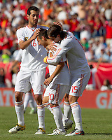 Spain midfielder Santiago Cazorla (20) celebrates his goal with teammates. In a friendly match, Spain defeated USA, 4-0, at Gillette Stadium on June 4, 2011.