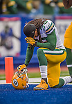 14 December 2014: Green Bay Packers cornerback Tramon Williams says a prayer prior to facing the Buffalo Bills at Ralph Wilson Stadium in Orchard Park, NY. The Bills defeated the Packers 21-13, snapping the Packers' 5-game winning streak and keeping the Bills' 2014 playoff hopes alive. Mandatory Credit: Ed Wolfstein Photo *** RAW (NEF) Image File Available ***