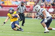 Landover, MD - September 23, 2016: West Virginia Mountaineers quarterback Skyler Howard (3) slides for  a first down during game between BYU and WVA at  FedEx Field in Landover, MD.  (Photo by Elliott Brown/Media Images International)