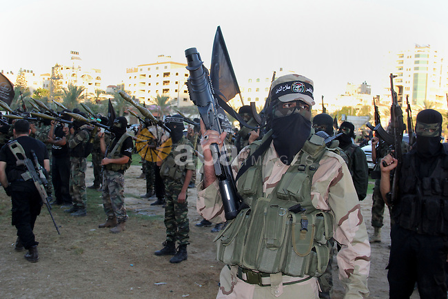 Palestinian militants from Al Nasser Brigades, an armed wing of the Popular Resistance Committees (PRC), take part in a training session in Gaza City, Sept. 28, 2013. Photo by Mosad al-Mahmuom