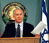 Washington, DC - January 21, 1998 -- Israeli Prime Minister Binyamin Netanyahu holds a copy of the Hebron Accords as he discusses them in detail before assembled reporters at the National Press Club..Credit: Ron Sachs / CNP