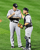 New York Yankees catcher Russell Martin (55) tries to calm down pitcher A.J. Burnett (34) during the second inning against the Baltimore Orioles at Oriole Park at Camden Yards in Baltimore, MD on Friday, August 26, 2011.  Burnett was tagged for six runs in the inning..Credit: Ron Sachs / CNP.(RESTRICTION: NO New York or New Jersey Newspapers or newspapers within a 75 mile radius of New York City)