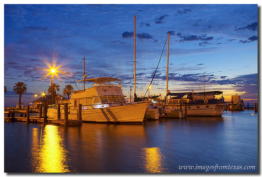 About 20 minutes before sunrise over Rockport, Texas, the horizon begins to show oranges, yellows and pastel reds. I love photographing Texas Gulf Coast images because of all the opportuties wtih boats, with color, and even seagulls (just not in this image, but others!). I think this is one of my favorite places to capture images from Texas, along with the Texas Hill Country during wildflower season and various vantage points of the Austin skyline.