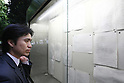 Apr 28, 2010 - Tokyo, Japan - A man looks at the resolution summary of Committee for the inquest of Ichiro Ozawa exhibited outside the Tokyo District Court on April 28, 2010. An independent judicial panel decided that Secretary General of the ruling Democratic Party of Japan merits indictment over his funding management body's alleged false reporting of political funds from 2004 to 2007.