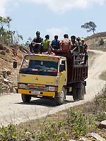 Local residents ride in the back of a truck, which acts as a kind of public transportation system near the mountain town of Soibada, Timor-Leste on Tuesday, Oct. 18th, 2011.  Photographer: Daniel J. Groshong/The Hummingfish Foundation