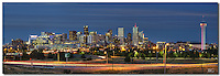 The Denver Skyline has a distinctive look. It's skyscrapers are architectural delights, and the nighttime cityscape is vibrant and alive. The tallest building in the downtown Denver area is the Republic Plaza, rising 728 feet with 56 floors. It was completed in 1984. <br /> <br /> In the foreground, the iconic Speer Boulevard Bridge connects West Denver to downtown.<br /> <br /> This Denver Panorama was captured on a summer night and looks east towards downtown.
