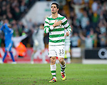 St Johnstone v Celtic.....12.04.11.Beram Kayal pats the Celtic badge to fans at full time.Picture by Graeme Hart..Copyright Perthshire Picture Agency.Tel: 01738 623350  Mobile: 07990 594431