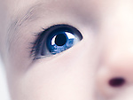 Closeup of a blue eye of a six month old baby boy. Digitally altered.