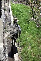 "Old farmer walking along the famous ""acequias"" (Moorish drainage channels), Bubion, Alpujarra, Andalucia, Southern Spain. Photograph by Manuel Cohen."