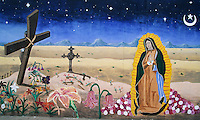 This exotic mural in the South Central district of Albuquerque, New Mexico, with its Salvador Dali like  curving cross, wilting flowers and crescent moon, create a surreal setting for the appearance of the Virgin of Guadalupe.