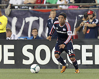 New England Revolution midfielder Lee Nguyen (24) looks to pass. In a Major League Soccer (MLS) match, the New England Revolution (blue) tied D.C. United (white), 0-0, at Gillette Stadium on June 8, 2013.
