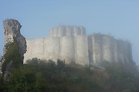 LES ANDELEYS, FRANCE - OCTOBER 10: View of the embossed ramparts and the keep, the drawbridge and the gate to the inner ward of the Chateau Gaillard in a fog, on October 10, 2008 in Les Andelys, Normandy, France. The chateau was built by Richard the Lionheart in 1196, came under French control in 1204 following a siege in 1203. It was later destroyed by Henry IV in 1603 and classified as Monuments Historiques in 1852. (Photo by Manuel Cohen)