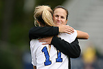 25 October 2009: Duke's Sara Murphy (11) is hugged by assistant coach Carla Overbeck. The Duke University Blue Devils defeated the Virginia Tech Hokies 4-1 at Koskinen Stadium in Durham, North Carolina in an NCAA Division I Women's college soccer game.