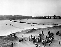 Refugees streaming across the frozen Han River on the ice as they flee southward before the advancing tide of Red Chinese and North Korea Communists.  Shattered bridges are shown in the background.  January 1951.  INP. (USIA)<br /> Exact Date Shot Unknown<br /> NARA FILE #:  306-PS-52-2719<br /> WAR &amp; CONFLICT BOOK #:  1478