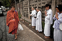 Mae Chees clad in white robes offer respects silently to a Monk passing by in the early morning light, holding out their alms bowls as they go out to the neighborhood streets to collect charity. Despite the most often Thai society consider nuns to be spiritually inferior to monks, every year several women enter nunhood in Thailand. Females who have turned to religous life, as renunciants, live ostracized and marginalized by the Sangha (Buddhist community) and Thai society, denying them full access to the monastic life as well as rights and support from the government. Today nunhood is not recognized by any asian country belong to the Theravada Buddhist order.