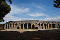 Amphitheatre, 1st century BC, Pompeii, one of the earliest examples. Backing on to the city wall it is elliptical in shape, its seating capacity was 20,000. Here we see one of 6 staircases in the outer wall leading to the auditorium