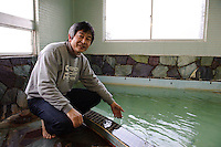 Inn owner Masahiro Ishikawa is an expert on Japanese hot springs, Sado island, Niigata, Japan, April 5, 2009..Sado island, off the north coast of Japan's main island, is famous as the home of the Kodo drummers and the annual Earth Celebration arts festival.