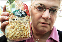 BNPS.co.uk (01202 558833)<br /> Pic: SallyAdams/BNPS<br /> <br /> ***Please use full byline***<br /> <br /> Mary Randall with the dried pasta from Tesco in Salisbury which had dozens of weevils crawling around in it.<br /> <br /> Fears have been raised that a batch of supermarket pasta could be contaminated with beetle bugs after a second customer discovered an infestation in a packet.<br /> <br /> Mary Randall, 60, was about to start cooking dinner when she found a swarm the black weevil bugs inside her unopened bag of fusilli pasta.<br /> <br /> Mrs Randall, from Ringwood, Hants, purchased the 500g bag from a branch of Tesco in Salisbury.<br /> <br /> She is the second person in as many weeks to have discovered the swarm of bugs in the 'Cook Italian' pasta packets.