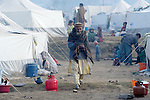 Following an October 8, 2005, earthquake, a displaced man walks through a tent city outside Balakot sponsored by Action by Churches Together. The quake measured 7.6 on the Richter scale and killed more than 74,000 people in northern Pakistan.