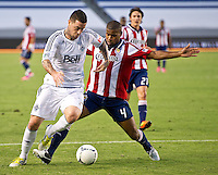CARSON, CA - July 7, 2012: Vancouver Whitecaps forward Eric Hassli (29) and Chivas USA defender Rauwshan McKenzie (4) during the Chivas USA vs Vancouver Whitecaps FC match at the Home Depot Center in Carson, California. Final score Vancouver Whitecaps FC 0, Chivas USA 0.