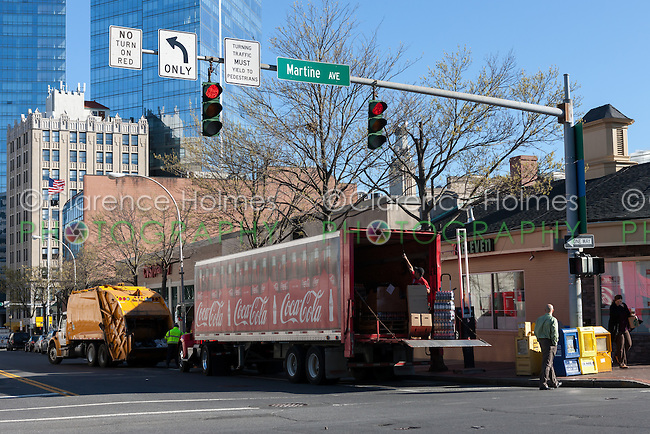 Morning Coca-cola delivery and garbage collection start the day in White Plains, New York